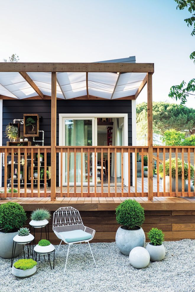Outdoor Roll Up Shades Lowes with Contemporary Landscape  and Balustrade Deck Outdoor Seating Area Pergola Planters Sunken Seating Area White Wire Chair