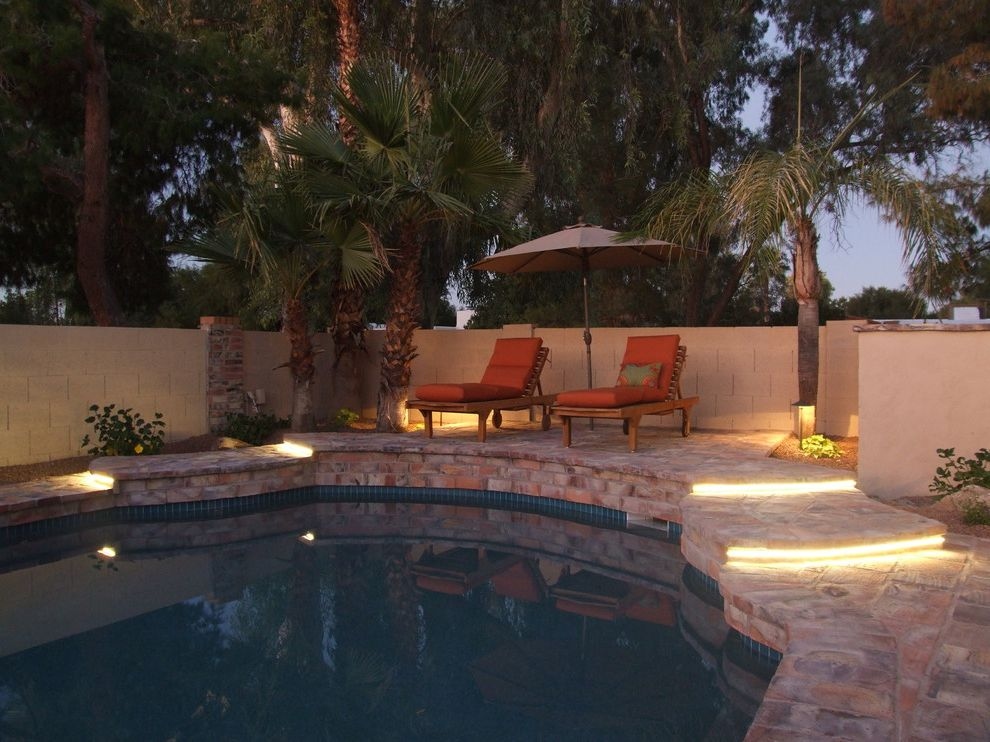 Outdoor Strand Lighting   Mediterranean Pool  and Brick Chaise Lounge Exterior Seating Orange Outdoor Cushion Outdoor Lighting Outdoor Seating Palm Tree Patio Umbrella Paver Planter Pool Ribbon Lighting Stair Step Stone Wall Wall