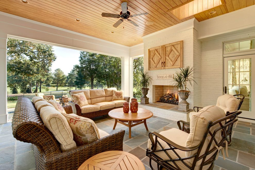 Outdoor Tv Cabinet Plans with Traditional Patio  and Ceiling Fan Covered Patio French Doors Outdoor Fireplace Seat Cushions Sky Light Slate Tile Floor Tongue and Groove Transom Window View Wood Ceiling Woven Outdoor Furniture