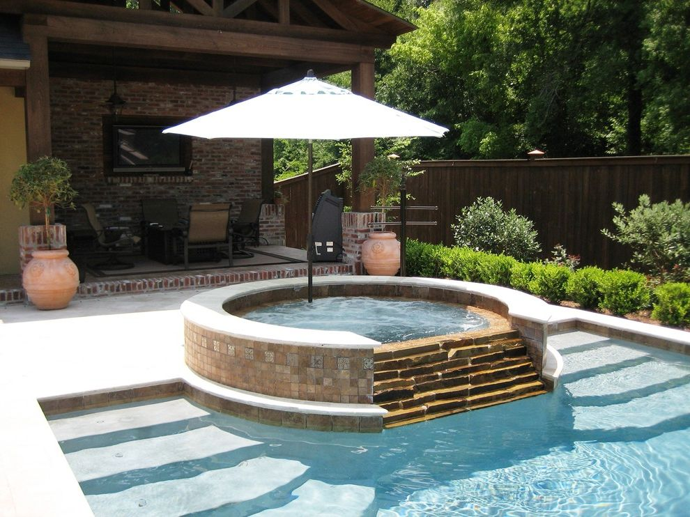 Outside Umbrella Stand with Traditional Pool  and Brick Covered Patio Hot Tub Outdoor Lounge Outdoor Tv Patio Pool Potted Plants Shrub Tile Umbrella Wood Fence
