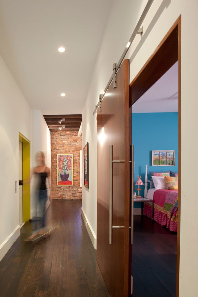 Outwater Hardware   Contemporary Hall  and Barn Door Brick Wall Exposed Brick Framed Art Yellow Door Frame