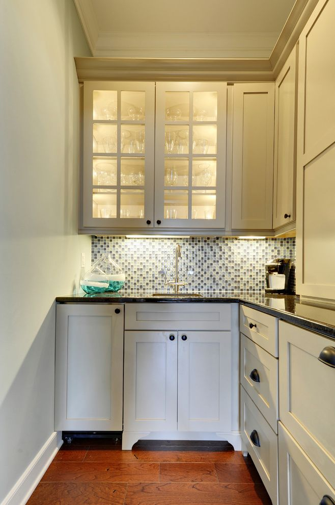 Outwater Hardware with Traditional Kitchen Also Drawer Pulls Frame and Panel Cabinets Glass Front Cabinets Mosaic Tile Backsplash White Painted Wood White Trim Wood Floor