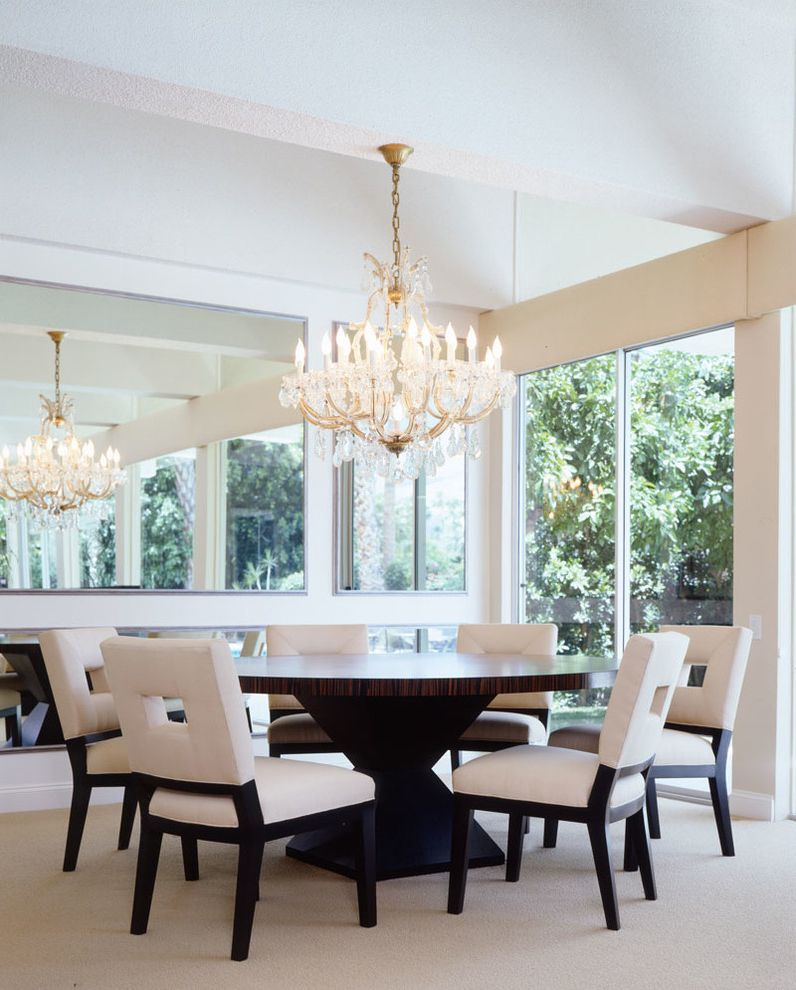 Oval Dining Table Pedestal Base   Contemporary Dining Room  and Beige Carpet Beige Dining Chairs Chandelier Gold High Ceiling Large Mirror Round Dining Table Sliding Door White Walls
