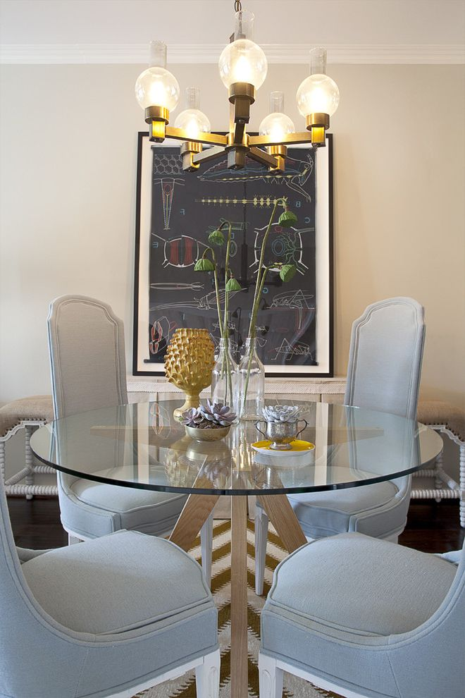 Oval Dining Table Pedestal Base   Contemporary Dining Room  and Centerpiece Chandelier Crown Molding Floral Arrangement Glass Dining Table Neutral Colors Round Dining Table Upholstered Dining Chairs Wall Art Wall Decor White Wood Wood Trim