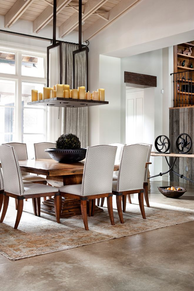 Oval Dining Table Pedestal Base   Traditional Dining Room  and Area Rug Candle Chandelier Chevron Concrete Floor French Doors Gray Drapes Iron Pedestal Dining Table Rustic Transom Window Transom Windows Upholstered Dining Chairs Wood Ceiling Wood Table