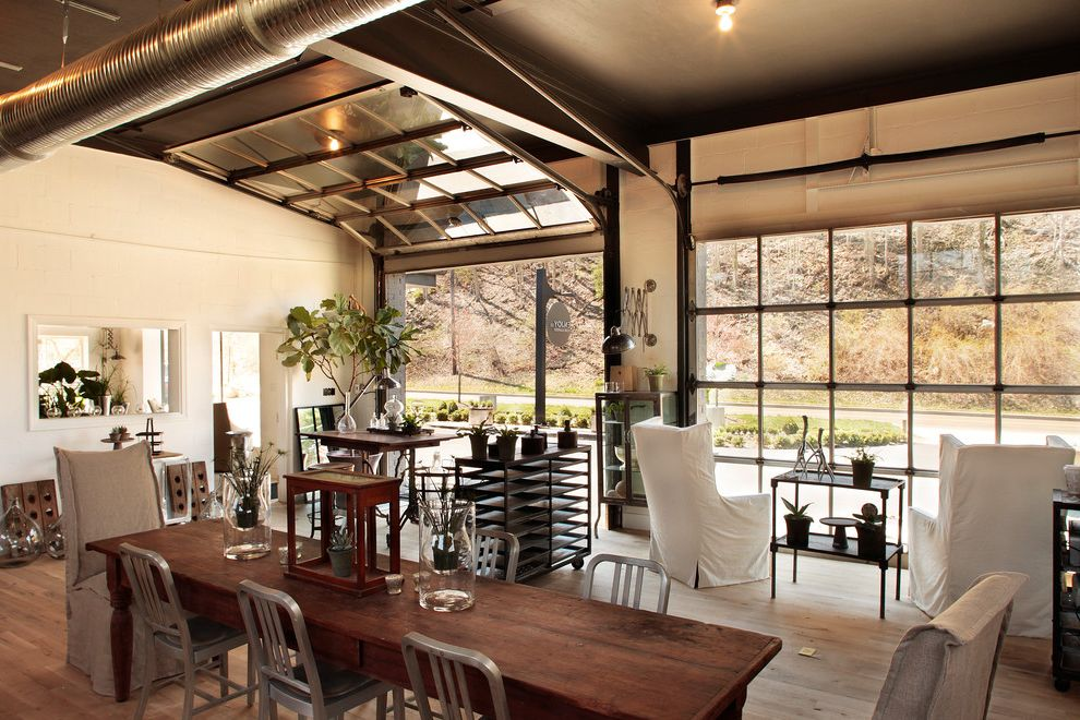 Overhead Door Abilene with Eclectic Living Room Also Aluminum Side Chairs Glass Garage Door Exposed Ducting Garage Doors Industrial Furniture Painted Ceiling Seating Area Slipcovered Chairs View White Walls
