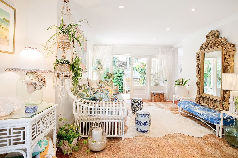 Oversized Hangers with Eclectic Family Room and Bamboo Occassional Table Blue Porcelaine Stools Bronwyn Poole Cane Lounge Carved Oversized Mirror Lace Curtains Macrame Planter Touch Interiors White Cowhide