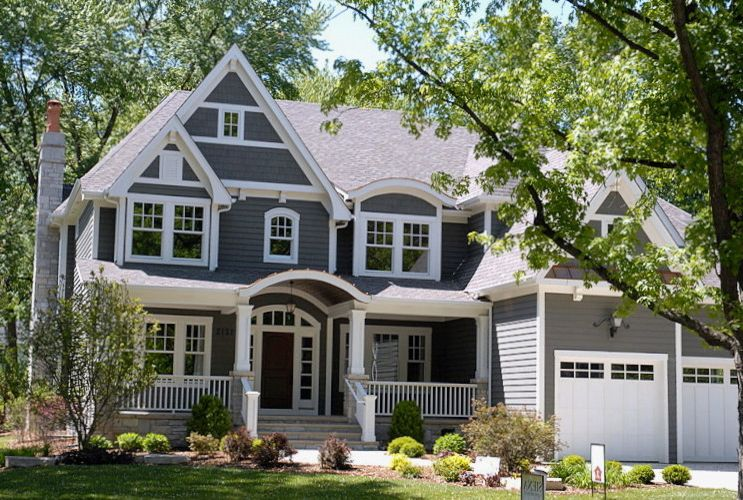 Owen Corning   Traditional Exterior  and Door Fireplace Fireplace Chase Front Door Front Porch Garage Doors Green Landscaping Lights Porch Stone Trim White Windows