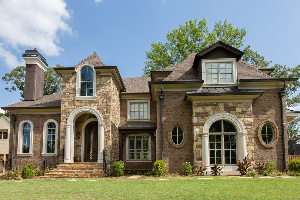Owen Corning with Traditional Exterior Also Arch Entryway Arched Front Door Arched Window Archway Awning Beige Window Trim Brick Chimney Brick Exterior Brick Siding Column Grass Lawn Oval Window Pillar Stone Exterior Stone Siding Stone Stairs