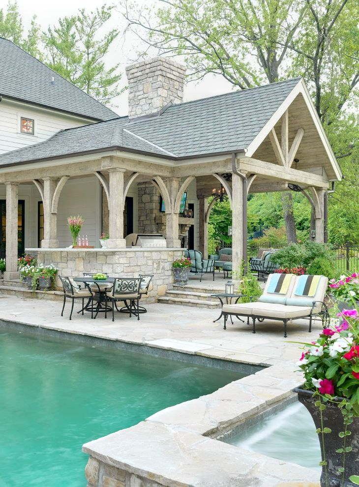 Painters Memphis   Traditional Patio  and Brick Brick Chimney Covered Patio Exterior Garden Seating Outdoor Fireplace Outdoor Television Patio Deck Patio Furniture Pool Stone Stone Wall Swimming Pool Wood Beam