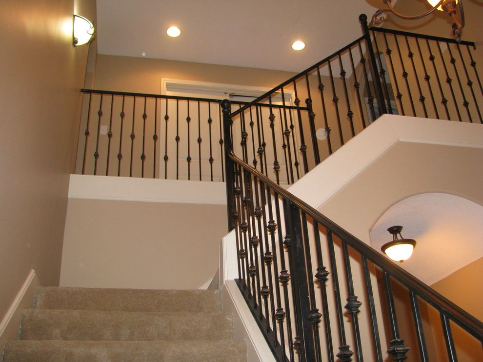 Painters Memphis   Traditional Staircase  and Beige Colored Walls Beige Wall Color Carpet Stair Runner L Shaped Staircase Memphis Exterior Painter Memphis Interior Painter Memphis Painter Metal Railing Stairs Shaker Beige Wall Color