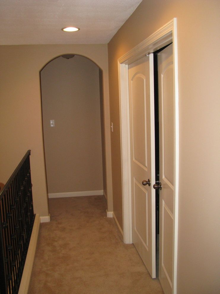 Painters Memphis with Traditional Hall  and Beige Colored Walls Beige Wall Color Carpet Stair Runner L Shaped Staircase Memphis Exterior Painter Memphis Interior Painter Memphis Painter Metal Railing Stairs Shaker Beige Wall Color