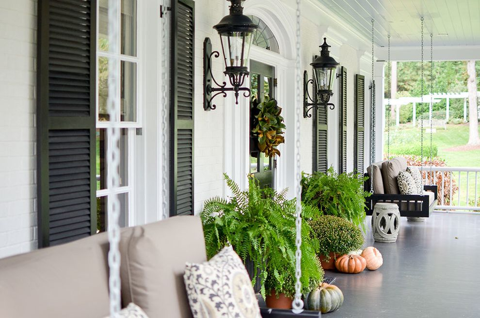 Panasonic Whisper Green Fan   Traditional Porch Also Balcony Black Door Black Hanging Bench Black Shutters Chinese Garden Stool Fan Window Potted Plants Pumpkin Swing Bench Transom Windows