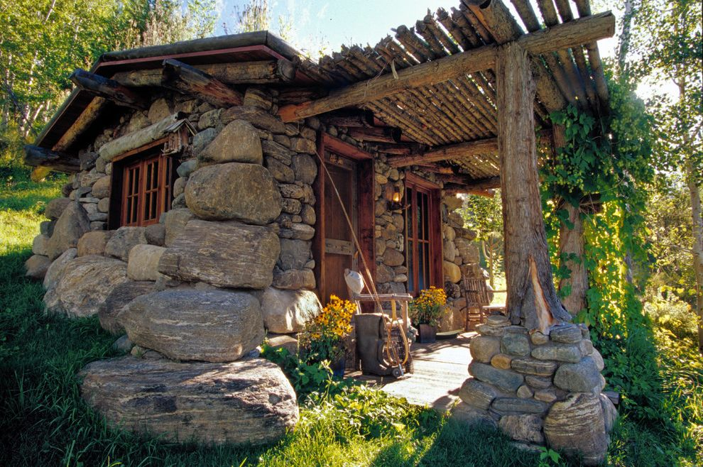 Paris Landing Cabins with Rustic Exterior and Birdhouse Boulder Cabin Fishing Cabin Logs Montana Porch Rustic Stone Stone Cabin Timbers Twigs Wood Trim