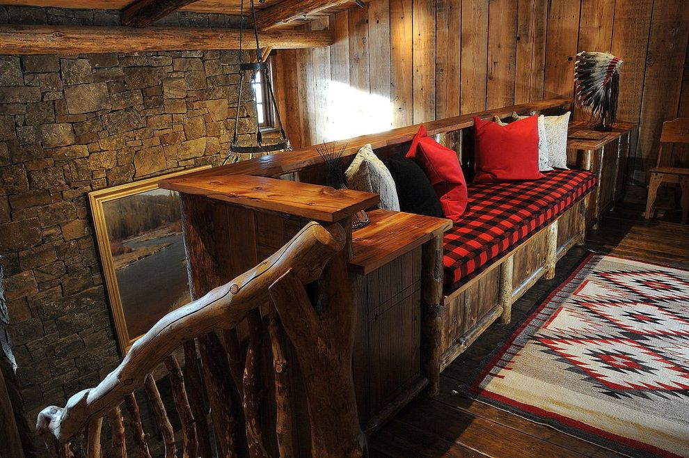 Paris Landing Cabins with Rustic Hall and Area Rug Branch Banister Buffalo Plaid Built in Bench Cabin Decorative Pillows Landing Lodge Rustic Stone Wall Throw Pillows Wood Flooring Wood Paneling