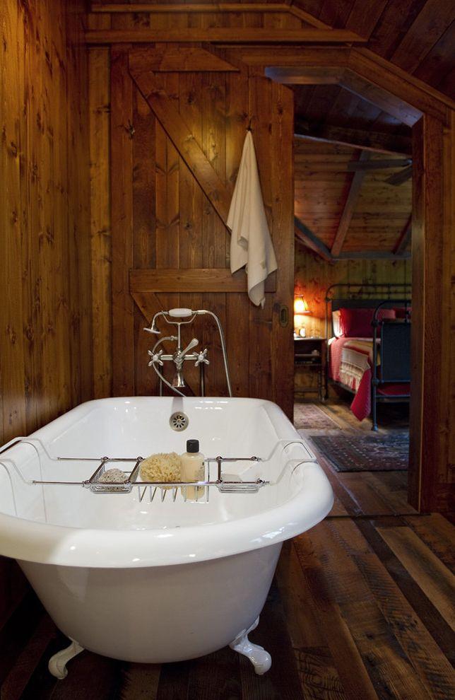 Paris Landing Cabins with Traditional Bathroom and Bathtub Caddy Bathtub Tray Cabin Claw Foot Tub Dark Floor Freestanding Bathtub Pocket Door Sliding Door Wood Flooring Wood Paneling