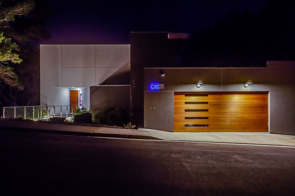 Parker Garage Doors with Contemporary Exterior Also Bridge Entry Dramatic Lighting Drivewya Flat Roof Garage Door Glass Panel Door Gray Siding House Numbers Illuminated Lighting Minimalist Monochromatic One Story Railings Stucco Wood Garage Door