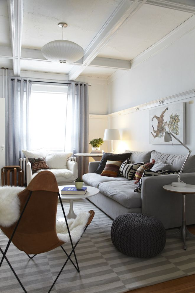 Parkway Lofts with Scandinavian Living Room Also Butterfly Chair Chais Stacking Tables Coffered Cieling Curtain Panels Gray Lamp Leather Pouf Sheepskin Side Table Sofa Striped Area Rug Wood Floor Woven