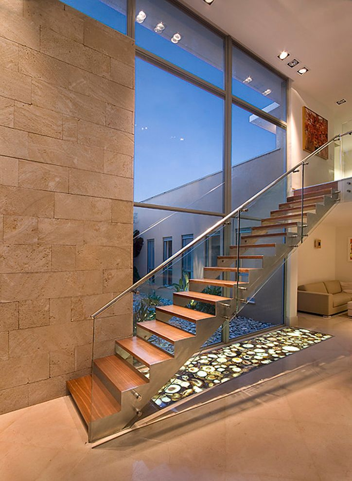 Paso Robles Glass with Modern Staircase  and Ceiling Lighting Floating Staircase Glass Railing Glass Wall Handrail Metal Staircase Minimal Neutral Colors Recessed Lighting Stone Flooring Stone Wall Straight Stairs Wood Staircase