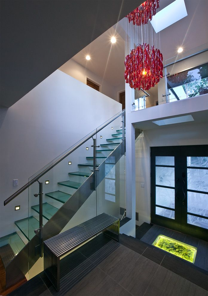 Paso Robles Glass with Modern Staircase  and Dark Floor Dark Wood Bench Floating Stairs Frosted Glass Glass Stair Railing Glass Staircase Glass Stairs Red Chandelier Skylight Staircase Staircase Lighting White Wall
