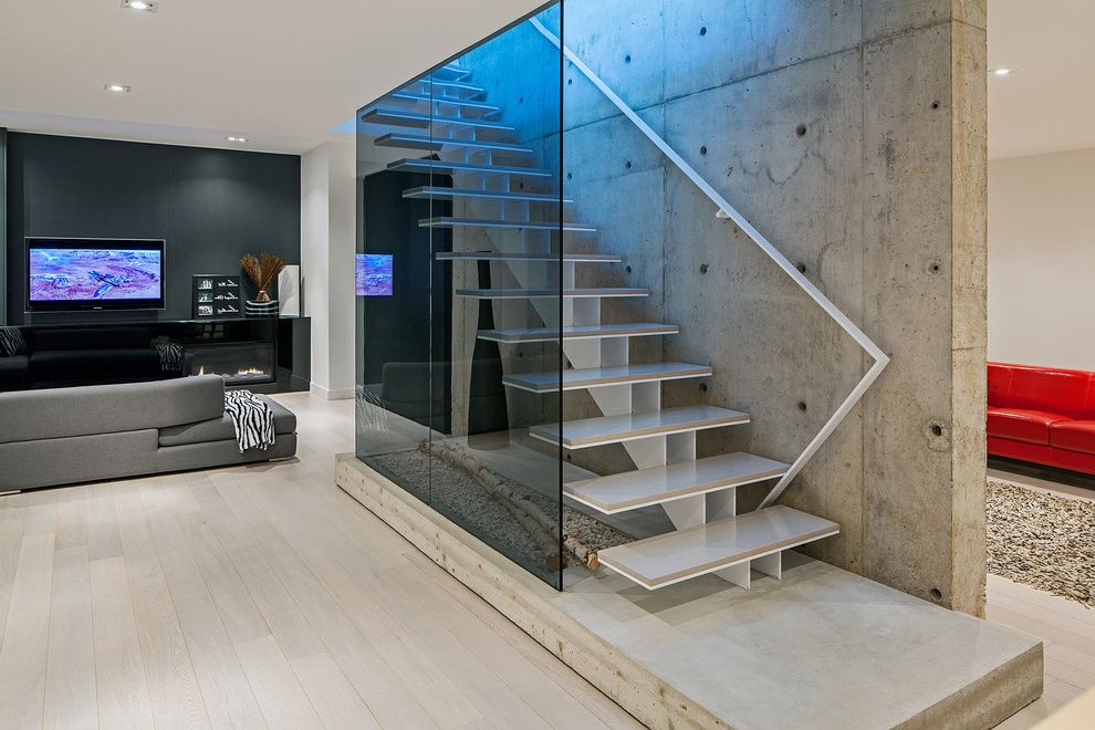 Paso Robles Glass with Scandinavian Staircase  and Accent Wall Basement Black Wall Concrete Wall Dark Wall Freestanding Staircase Glass Guardrail Great Room Minimal Modern Fireplace Open Floor Plan Open Risers Platform Red Accent