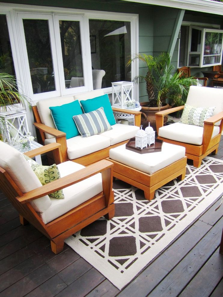 Patio Furniture Under $300 with Contemporary Deck  and Area Rug Container Plants Deck Decorative Pillows Lanterns Outdoor Cushions Outdoor Rug Patio Furniture Potted Plants Serving Tray Throw Pillows White Wood Wood Trim