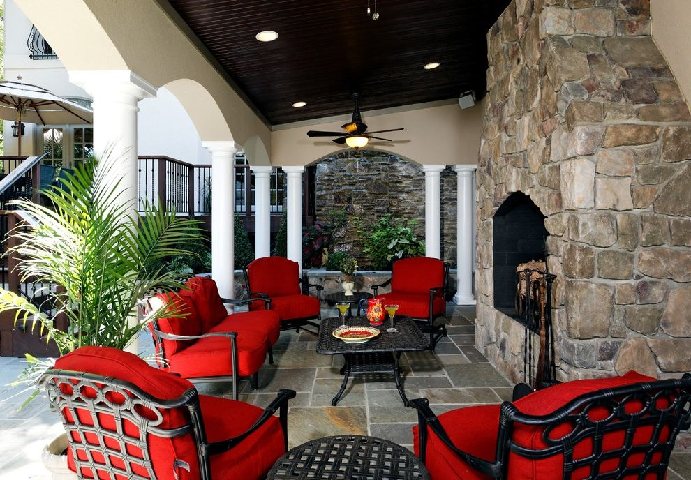 Patio Furniture Under $300 with Traditional Patio  and Archway Ceiling Fan Columns Covered Patio Fireplace Accessories Outdoor Cushions Outdoor Fireplace Patio Furniture Pavers Recessed Lighting Stone Fireplace Surround Stone Paving Wood Paneling