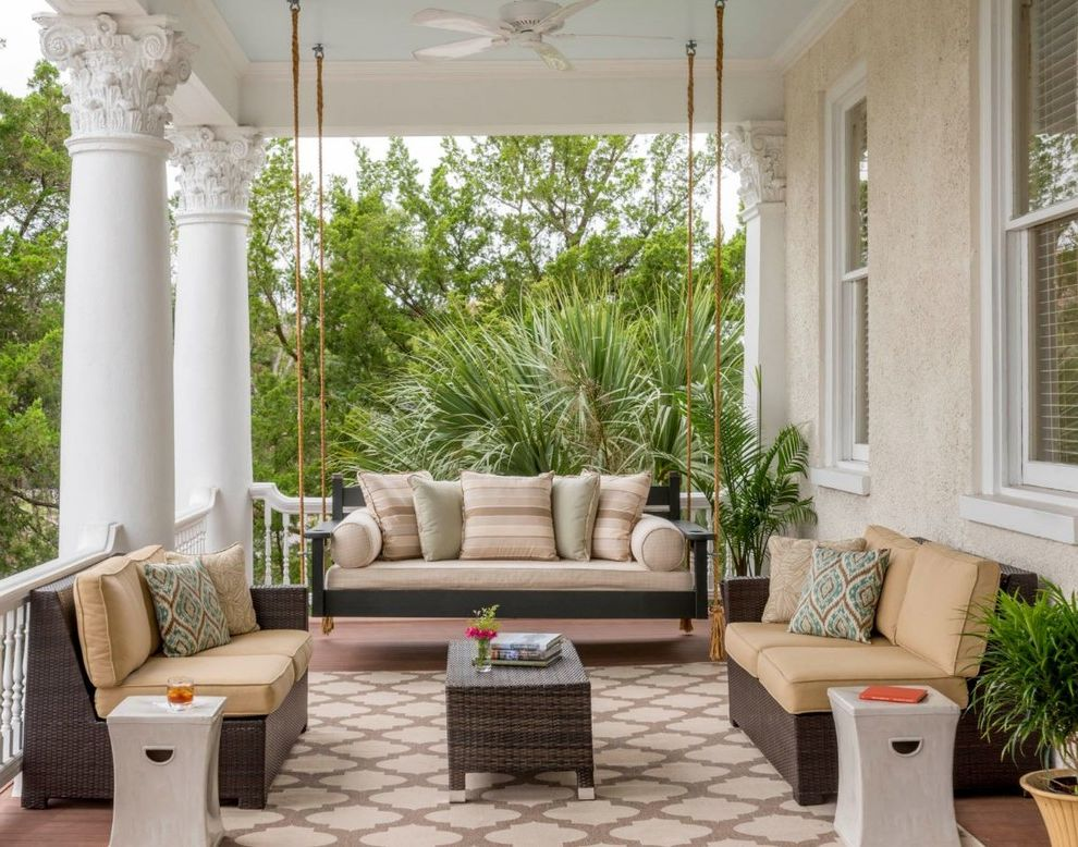 Patio Swing Set with Canopy   Transitional Porch Also Beige and Brown Area Rug Dark Wicker Furniture Gray Side Table Green Accent Pillow Ornate Columns Porch Swing Swinging Sofa White Fan Yellow Cushions