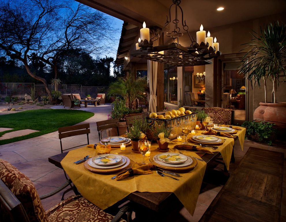 Patio Table Covers Rectangular with Mediterranean Patio  and Al Fresco Chandelier Covered Patio Dining Bench Lemons Outdoor Dining Patio Furniture Potted Plants Southwestern Style Table Setting Tea Lights Yellow Tablecloth