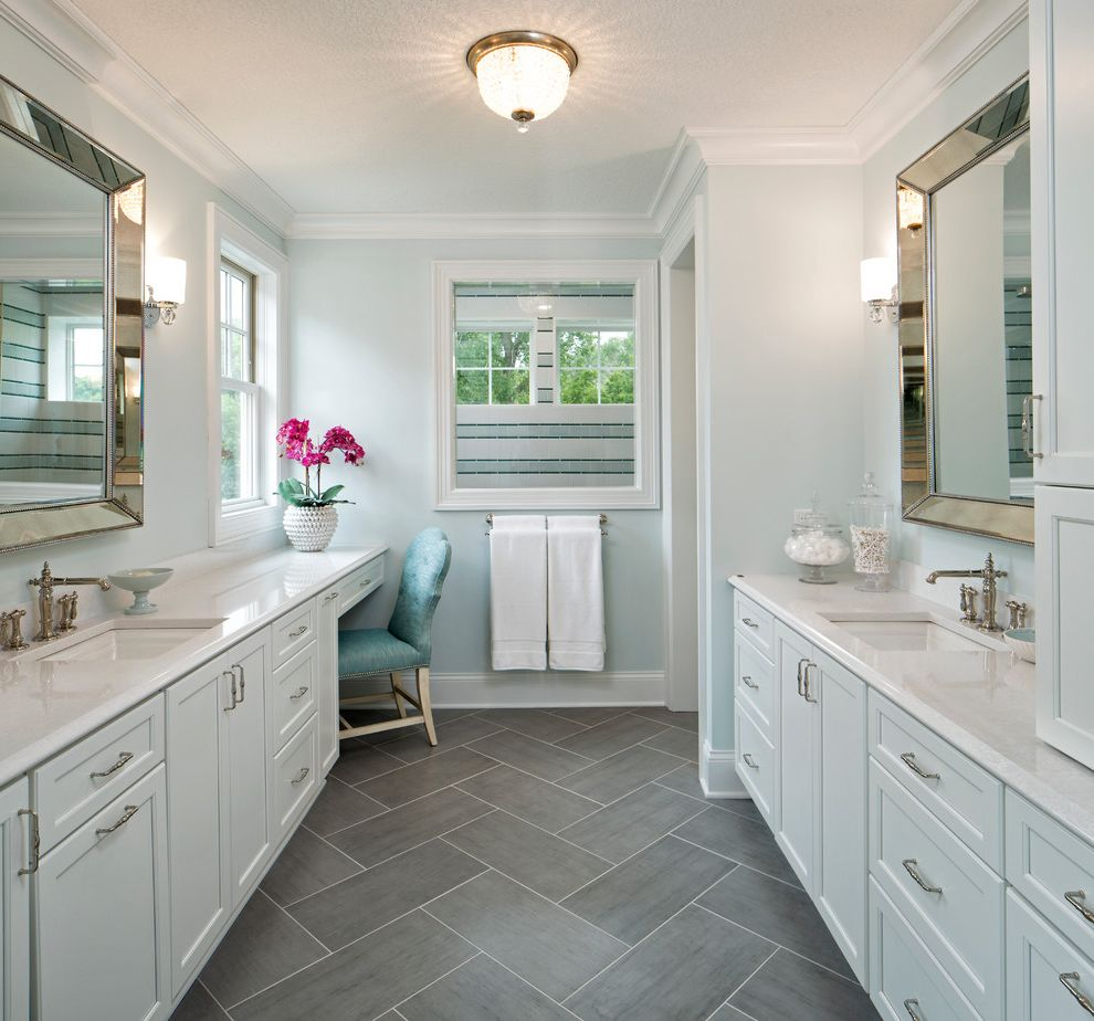 Patterned Ceramic Floor Tile   Transitional Bathroom Also Apothecary Jar Bath Towels Casual Elegance Flush Mount Light Framed Wall Mirror Herringbone Tile His and Hers Light Blue Makeup Vanity Spa Bath Two Sinks Vanity Chair Window