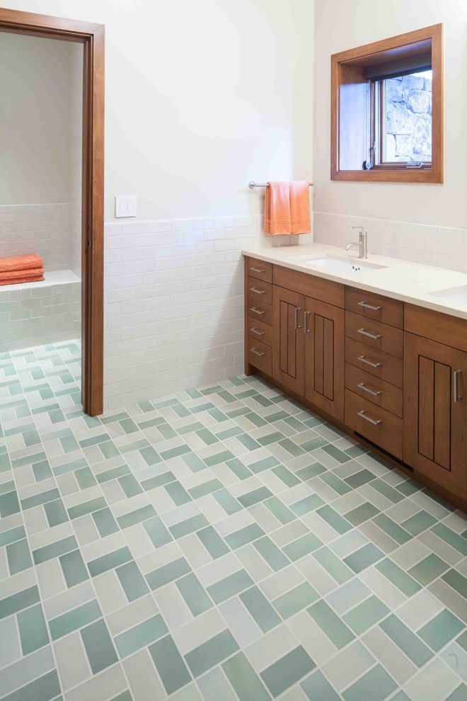 Patterned Ceramic Floor Tile with Rustic Bathroom Also Accent Tile Door Casing Double Sinks Double Vanity Heath Ceramics Herringbone Tile Rocky Mountain Hardware Rustic Subway Tile Tile Floor Wainscoting Wood Cabinets
