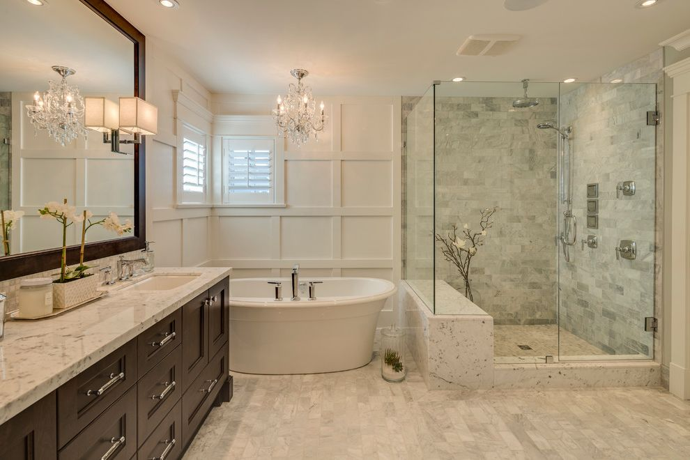 Patterned Ceramic Floor Tile with Traditional Bathroom Also Award Winning Builder Crystal Chandelier Double Sink Framed Mirror Luxurious Potlight Rainhead Two Sinks White Trim