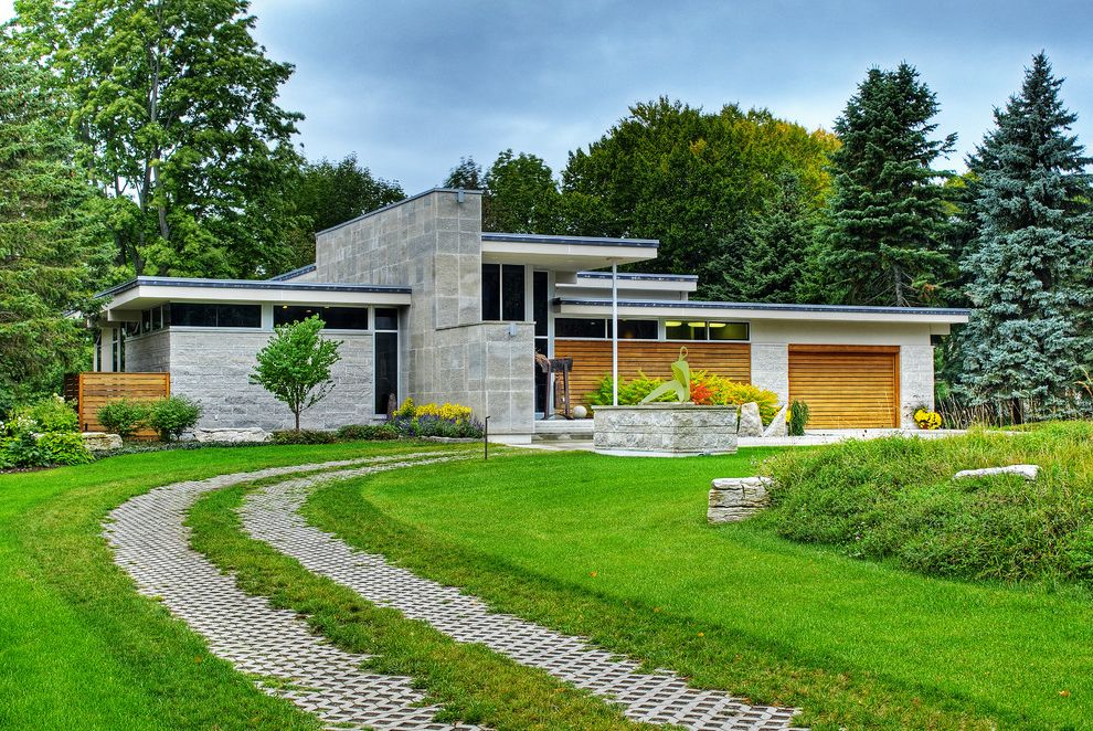 Paver Driveway Cost with Contemporary Exterior  and Flat Roof Grass Landscape Limestone Shrub Stone Exterior Stone Platform Stone Siding Tree Wood Fence Wood Garage Door Wood Siding