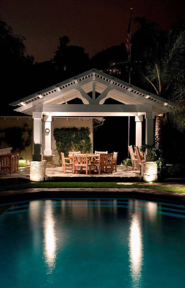 Pavillion Agency Inc   Traditional Patio  and Aquatic Counter Stools Covered Patio Dining Table Grass Hardscape Landscape Landscape Lights Living Wall Outdoor Dining Outdoor Lighting Outdoor Living Palm Trees Pavers Pool Pool House Poolside Water Feature