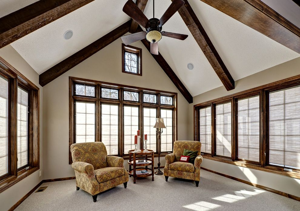 Pavillion Agency Inc with Traditional Porch  and All Season Porch Cedar Beams Ceiling Fan Integrated Shads Maple Trim Pella Windows Stained Trim Vaulted Ceiling Windows with Grids