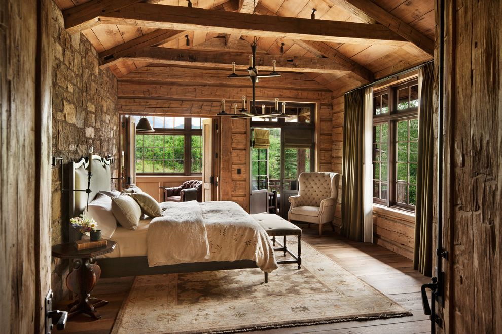 Pearson Place at Avery Ranch with Rustic Bedroom Also Area Rugs Armchairs Beams Bedding Bench at End of Bed Cabin Chandelier Curtains Night Stand Pillows Rustic Elegance Stone Wall Vaulted Ceilings Windows