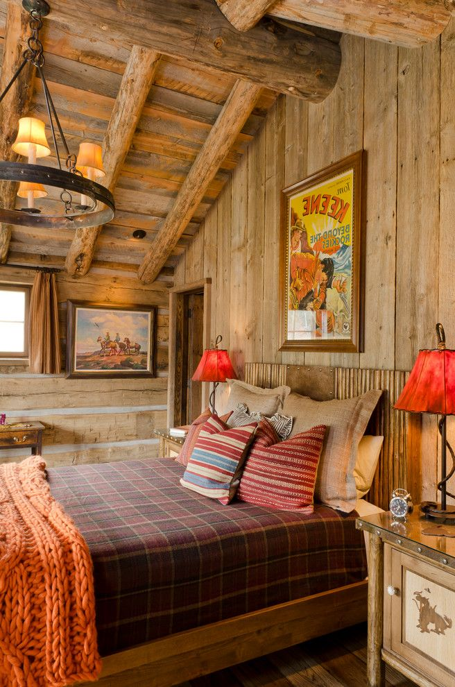 Pearson Place at Avery Ranch with Rustic Bedroom  and Chinking Chunky Yarn Large Knit Blanket Lodge Log Beams Orange Plaid Red Rough Hewn Rustic Table Lamps Vaulted Ceiling Vintage Movie Posters Window Curtains Wood Ceiling Wood Walls