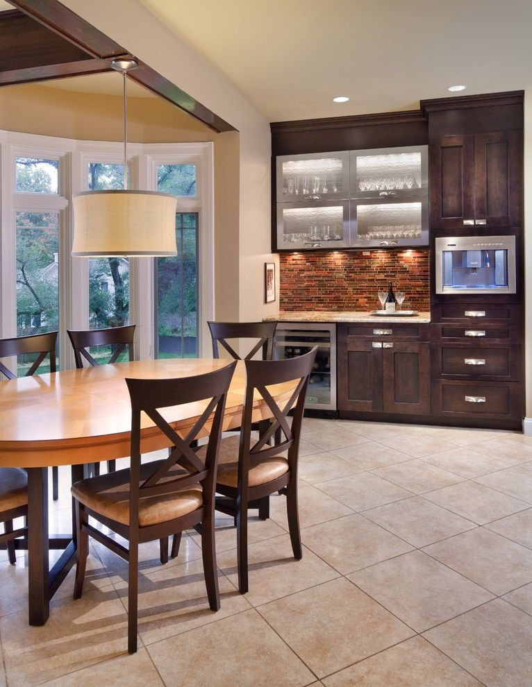 Pellet Ice Maker with Contemporary Kitchen  and Bay Window Beverage Cooler Built in Coffee Maker Dark Stained Wood Drum Shade Frame and Panel Wood Cabinet Doors Glass Front Cabinets Oval Dining Table Pendant Light Tile Backsplash White Painted Trim