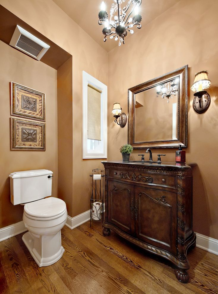 Penny Mustard Furniture with Traditional Bathroom  and Alcove Art Base Board Carved Wood Chadelier Dark Stained Wood Lamp Shade Roller Shade Single Sink Vanity Wall Sconce White Trim Wood Floor Wood Framed Mirror