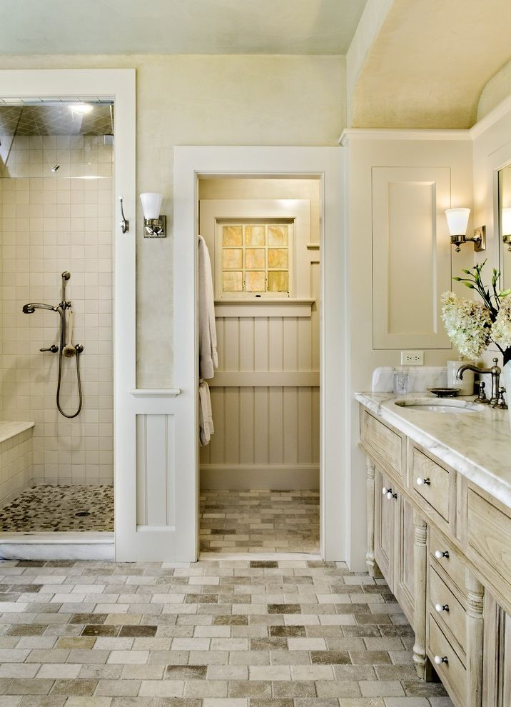 Pergo Flooring Reviews   Traditional Bathroom  and Beadboard Limestone Floors Sconce Stone Tile Floors Wainscoting Walk in Shower Wall Lighting White Trim
