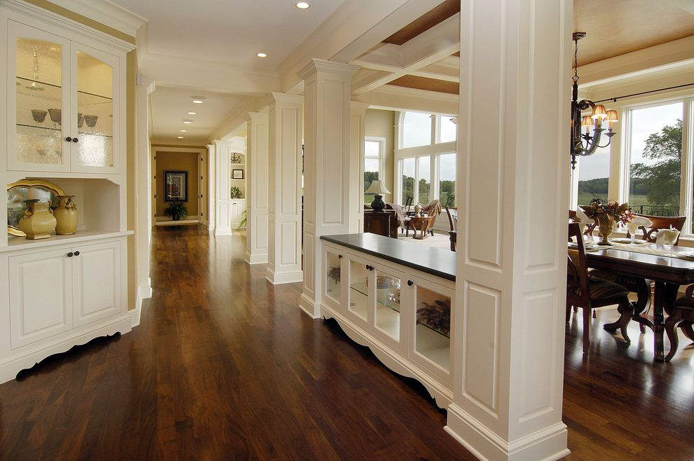 Pergo Flooring Reviews with Traditional Hall  and Ceiling Lighting Coffered Ceiling Dark Floor Dining Buffet Dining Hutch Footed Cabinets Glass Front Cabinets Recessed Lighting Room Dividers Walnut Floor White Wood Wood Flooring Wood Molding