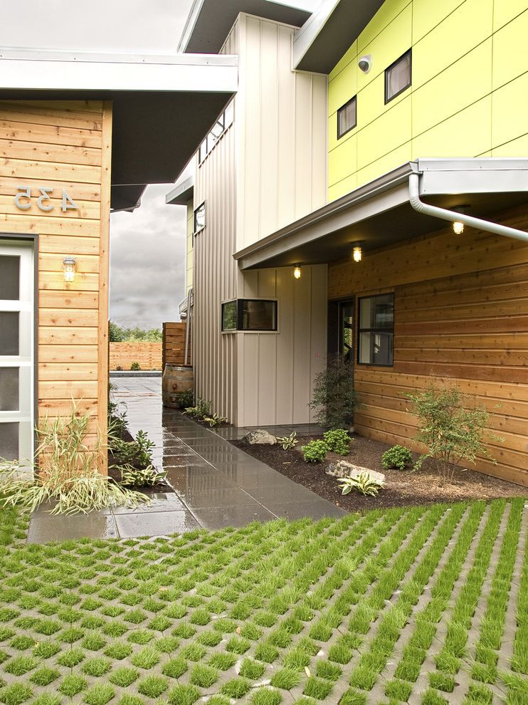 Permeable Pavers Cost   Contemporary Exterior  and Concrete Paving Corner Windows Driveway Entrance Entry Geometric Geometry House Numbers Outdoor Lighting Path Permeable Paving Roof Line Walkway Wood Siding