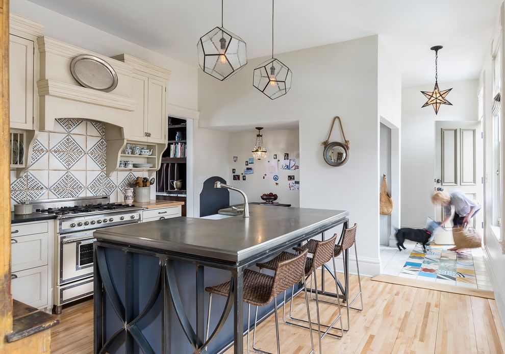 Pewter Light Fixtures with Farmhouse Kitchen Also Blue Island Ceramic Tile Colorful Tile Entry Geometrical Pendant Lighting Silver Oval Tray Woven Bar Stools