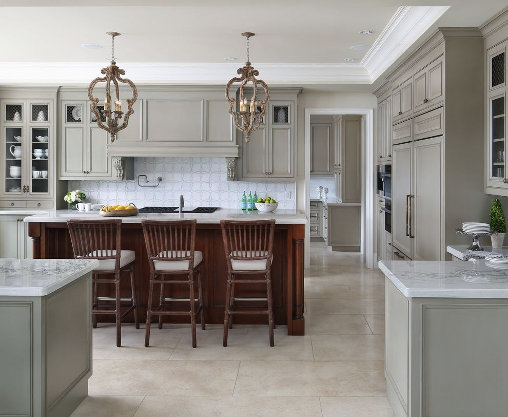 Pewter Light Fixtures with Transitional Kitchen Also Beige Floor Tile Crown Molding Dark Wood Island Pendant Lights Soffit White Countertop Wood Bar Stools