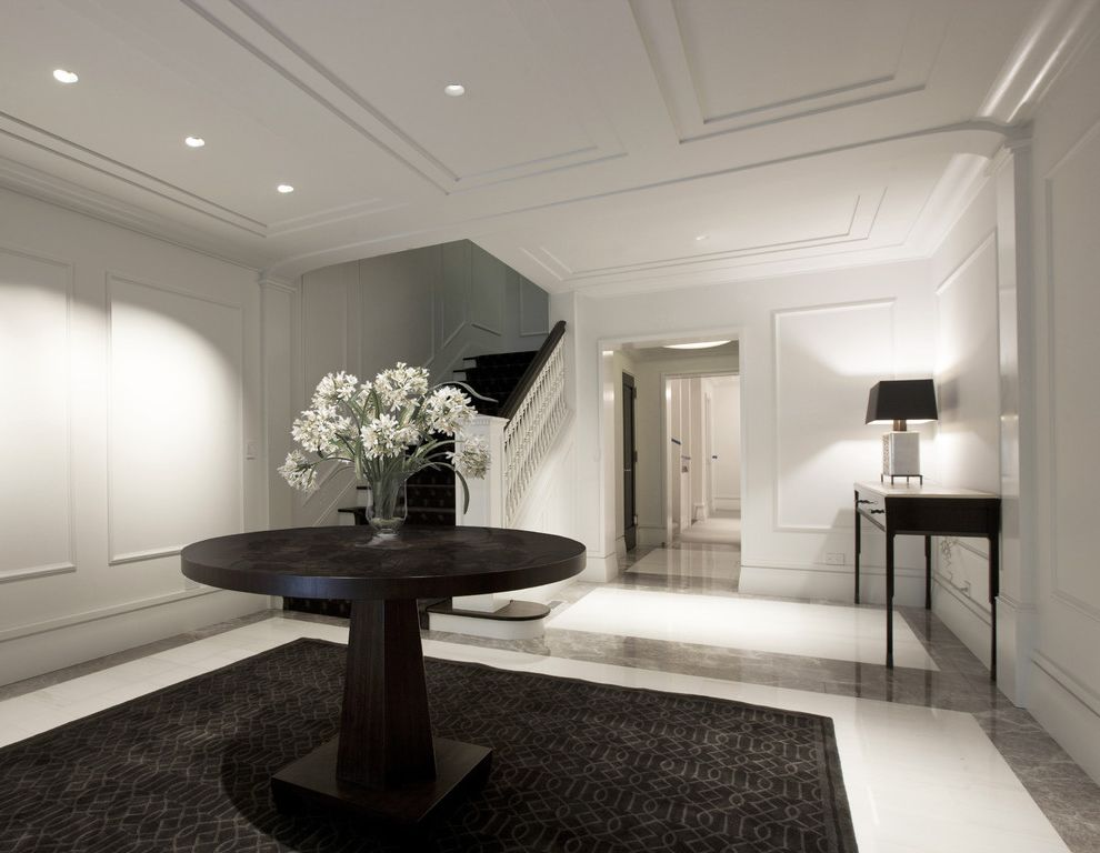 Photo Studio Rental Nyc   Contemporary Entry  and Area Rug Console Table Dark Stained Wood Frame and Panel Ceiling Frame and Panel Walls Hallway Marble Floor Recessed Lights Round Entry Table Spindles Square Newel Staircase Table Lamp Trimless Downlight