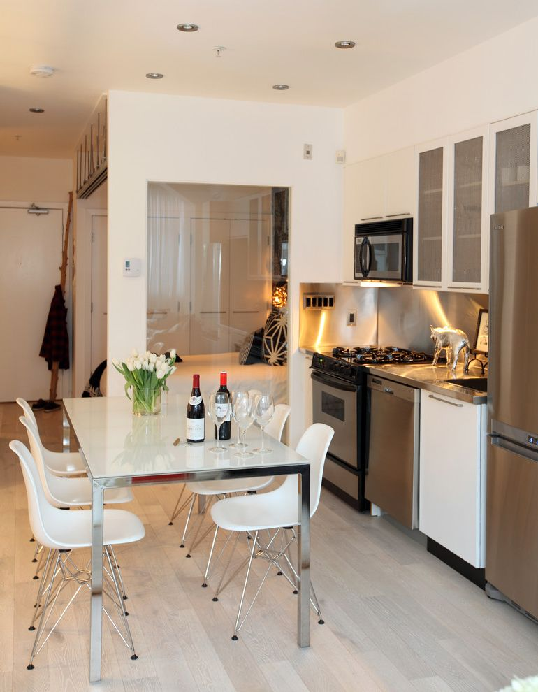 Photo Studio Rental Nyc   Contemporary Kitchen  and Eames Shell Chairs Eat in Kitchen Kitchen Table Lacquer Light Wood Floors Pig Stainless Steel Backsplash Studio Apartment Translucent Glass Cabinet Doors White Dining Chairs White Dining Table
