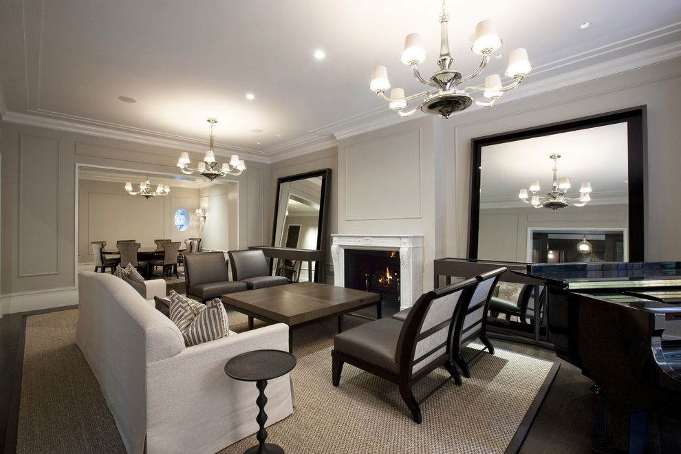 Photo Studio Rental Nyc   Contemporary Living Room  and Accent Table Area Rug Brown Leather Chandeliers Chrome Crown Molding Dark Stained Wood Fireplace Large Floor Mirror Mantel Piano Seating Area Silver Sofa White Trim