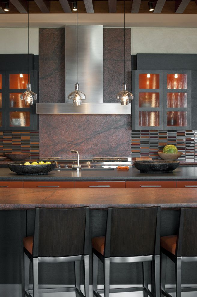 Picasso Granite   Southwestern Kitchen  and Breakfast Bar Earth Tone Colors Eat in Kitchen Glass Front Cabinets Kitchen Island Neutral Colors Orange Accent Range Hood Stainless Steel Appliances Tile Kitchen Backsplash