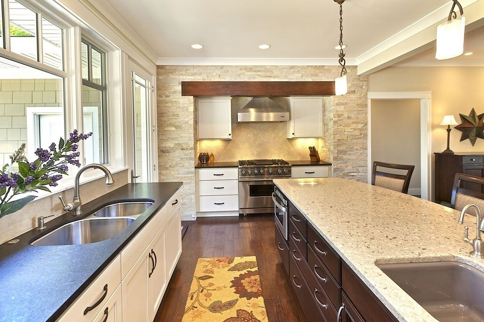 Picasso Granite   Transitional Kitchen  and Crown Molding Dark Floor Granite Countertops Island Lighting Kitchen Island Neutral Colors Pendant Lighting Quartz Range Hood Stainless Steel Appliances Two Tone Cabinets Under Cabinet Lighting Wood Flooring