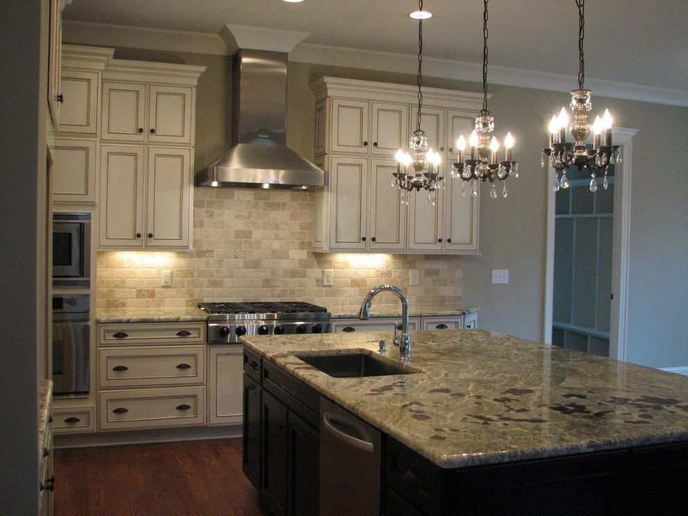 Picasso Granite with Traditional Kitchen  and Dacor Appliances Granite Kitchens Kraftmaid Cabinetry Lighting